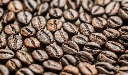 Roasted coffee beans on the background of linen fabric