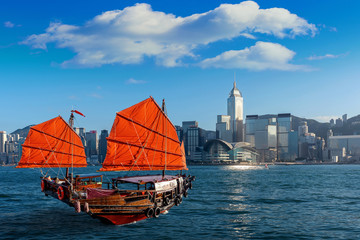Wall Mural - Victoria Harbour with junk ship in Hong Kong.