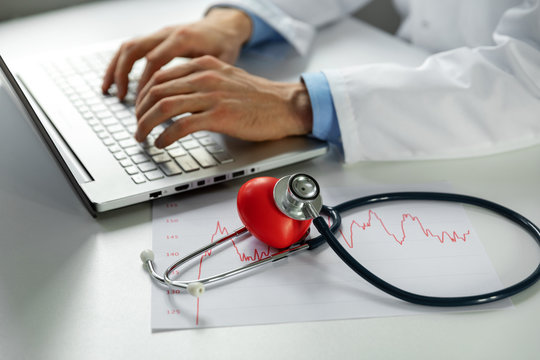 cardiology - doctor cardiologist working on laptop computer in office