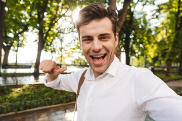 Happy young businessman wearing shirt