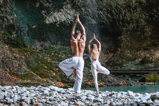 Advanced yoga instructors are engaged in nature