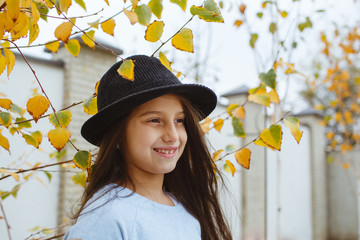 A smiling face with headphones. A photograph in the autumn season.