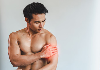 Asian man with muscular arm injury. From exercise on White background.