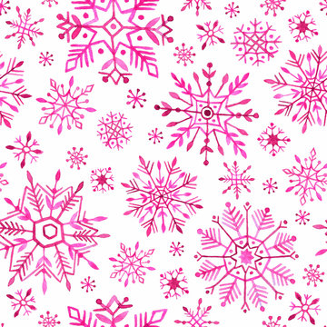Watercolor snowflakes seamless pattern. Pink snowflakes on a white background.