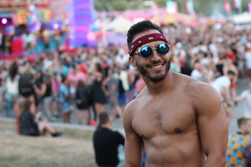 Gorgeous shirtless man standing out for the crowd
