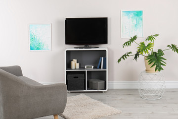 Modern TV set in living room interior