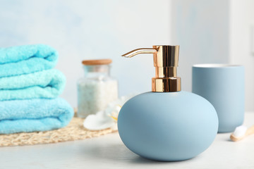 New stylish soap dispenser on table. Space for text