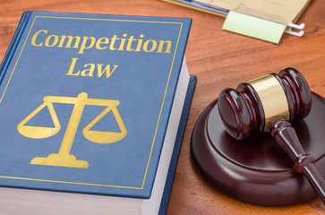 A law book with a gavel - Competition law