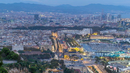 Aerial view over square Portal de la pau day to night timelapse in Barcelona, Catalonia, Spain.