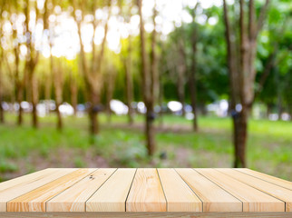 Old wood plank with abstract rubber plantation blurred background for product display