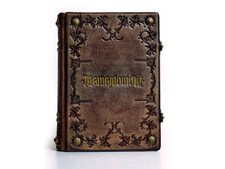 """Leather book with the Latin tittle """"Memento Mori"""". English translation of the Latin text is: """"Remember that you have to die""""."""