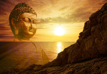 Figure of a buddha at sunrise in the sea