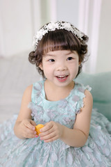 Little pretty Asian girl dressing as princess laughing portrait, healthy and happy lifestyle..