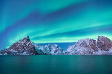Snow mountain with Aurora in the background/ travel concept world explore northern light / Lofoten norway