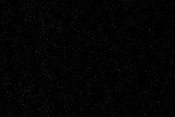 Isolated natural white snow texture effect on black night background. Winter snowflakes.