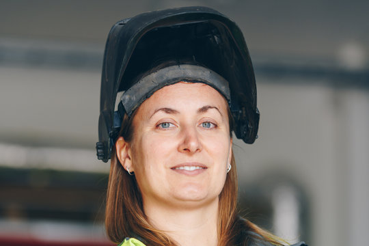 Close up portrait of female welder at work site