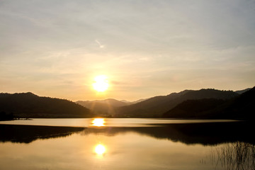 Mountains during sunset and lake. Beautiful natural landscape in the summertime