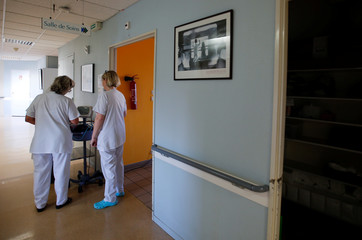 Nurses walk down the corridor at the Hospital Roland Mazoin in Saint-Junien
