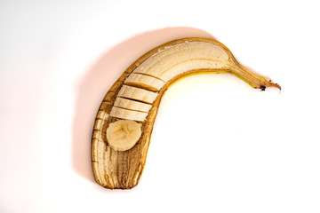 Sliced banana peel on a white background