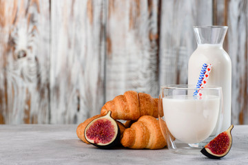 croissant with milk on a wooden background