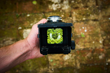 First person view through vintage TLR (Twin lens reflex) camera viewfinder. Selective focus