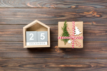 Christmas calendar 1 december. Christmas gift, fir branches on wooden white background. Copy space, top view