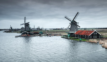Old Windmills on river coast near Amsterdam
