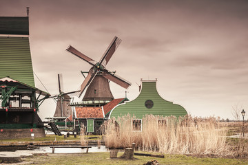 Old wooden barns and windmill on Zaan river