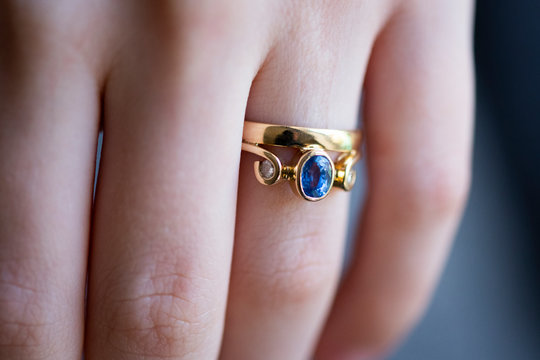 sapphire and diamond ring on hand