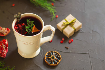 Mulled wine with spices and gifts on the table. Happy New Year! Top view