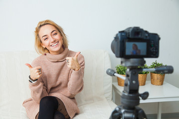 Creative young woman recording video blog for social media network.