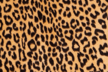 Fotobehang Luipaard Faux fur leopard texture background. Fashionable modern ecological material.