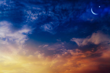 new moon .  Prayer time . Generous Ramadan .  Mubarak background . Glowing sunset . Sunset or sunrise with clouds . The sky at night with stars. Crescent moon with beautiful sunset background .