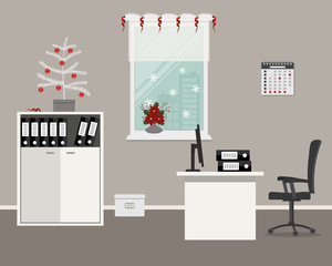 Workplace of office worker, decorated with Christmas decoration. There is a desk, chair, cabinet with folders and other objects on a window background in the image. There is also a Christmas tree here