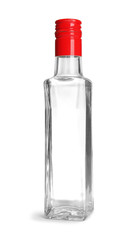 Glass bottle with vinegar on white background