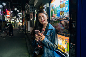 japanese woman relying on japan vending machines