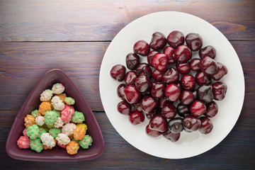 berry cherry on a plate on a wooden background. fruit diet. vegan food