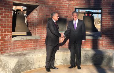U.S. Defense Secretary Mattis shakes hands with Philippines Ambassador Romualdez commemorating the return of the 'Bells of Balangiga' to the Philippines