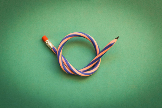 Flexible pencil . Isolated on light background. Bending pencil