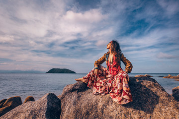 beautiful young gypsy style woman outdoors