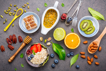 Ingredients for the healthy foods set up on dark stone background.