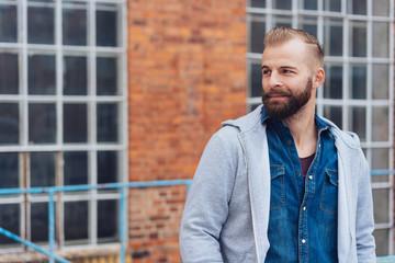 Handsome man with dark beard outdoor portrait