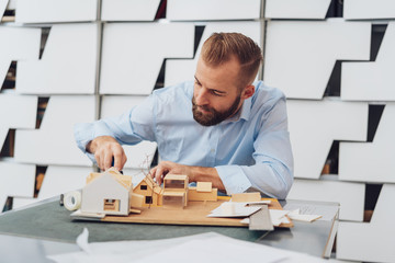 Male architect is working on 3D model