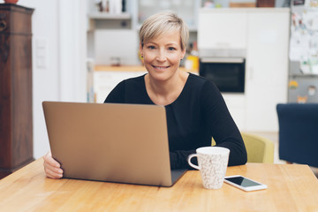 Friendly businesswoman working from home