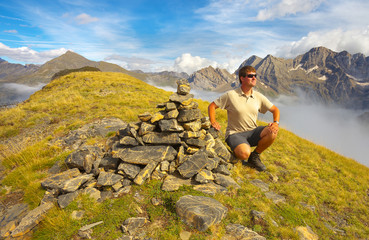 Resting tourist on the ridge with mountains on backround, Pyrenees