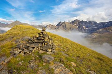 Stony pile on the ridge with mountains on backround, Pyrenees