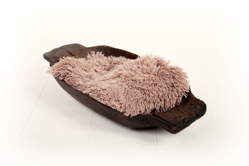 Wooden brown bowl with fluffy blanket