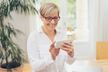 Woman scrolling through photos or the internet