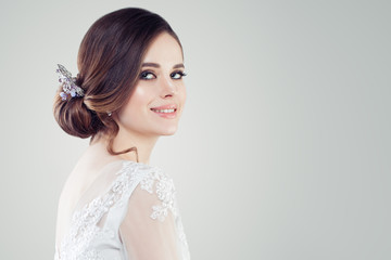 Charming young woman bride with makeup and bridal hairstyle. Pretty woman fiancee