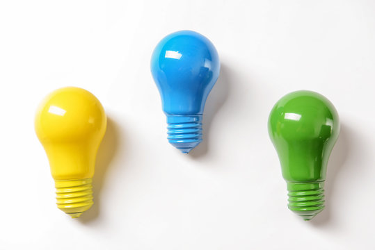 Colorful light bulbs on white background